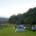Mankele kampplek met groen gras en tente